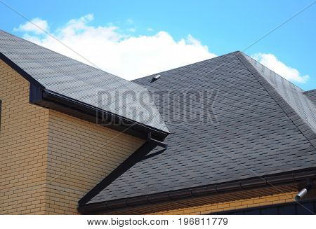 Asphalt shingles roofing construction repair. Problem Areas for House asphalt shingles Corner Roofing Construction Waterproofing. Rain gutter system.