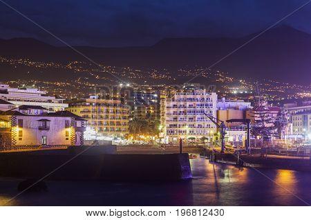 Puerto de la Cruz at night and Teide in the background Puerto de la Cruz Tenerife Canary Islands Spain.