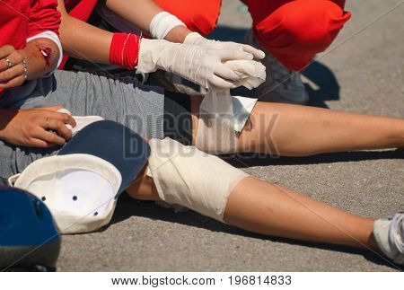 Paramedics Treating Injured Legs, Outdoors, Color Image, Close Up