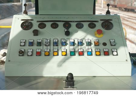 Train Guide Control Panel With Buttons And Knobs And Levers In A Freight Train Stationed At The Trai
