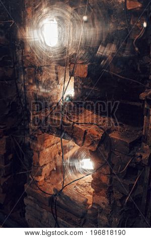 brick and lights behind a plastic window. the decor of the nightclub or restaurant in a loft style.
