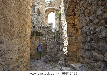Women walking through a portal in a ruin picture from the North of Cyprus.
