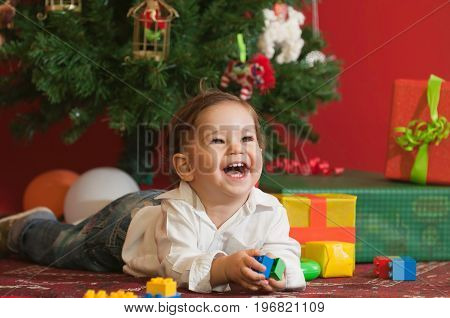Happy Baby Boy With Christmas Presents, Color Image, Smiling Little Boy