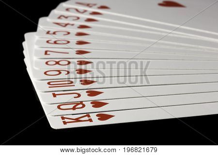 Hearts Cards Spread Out on black background.