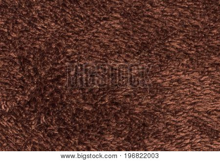 Double sided terry towelling fabric texture background. Brown color