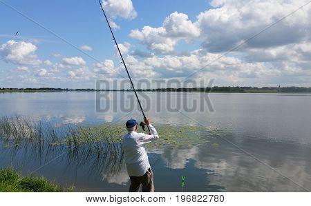 Fishing adventures. Beautiful lanscape. Fisherman near fishing equipment