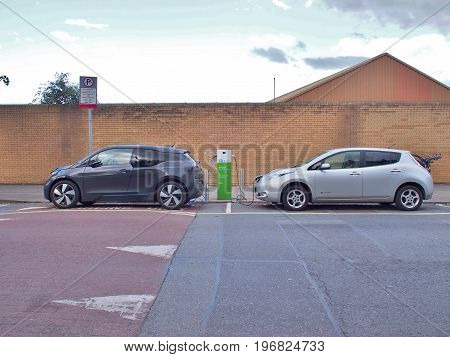 Dublin, Ireland - June 3, 2017: Electric Vehicle 'EV' charging electric power in battery at public charge point. Ecars operates and maintains 1,200 public charge points across the island of Ireland.