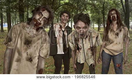 Portrait group of asian bloody zombies with wounded face in the woods