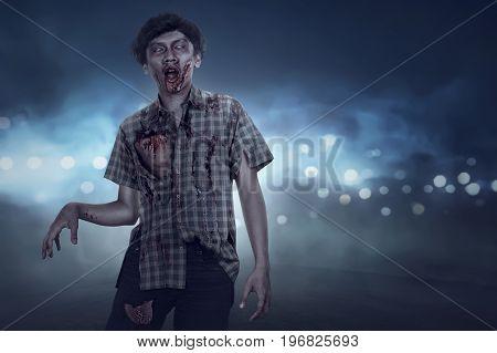 Aggressive Spooky Asian Zombie Man Walking
