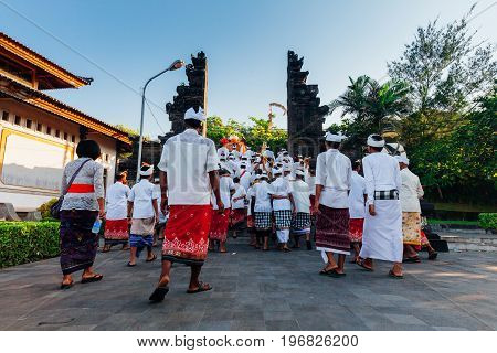 BALI INDONESIA - MARCH 07: Balinese people in traditional clothes take part in the ceremonial procession during Balinese New Year celebrations on March 07, 2016 in Bali, Indonesia.