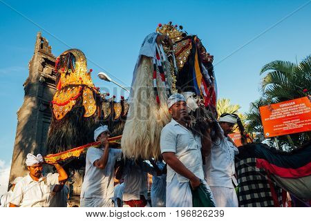 BALI, INDONESIA - MARCH 07: Balinese people in traditional clothes carry jempana or wooden litter at the procession during Balinese New Year celebrations on March 07, 2016 in Bali, Indonesia.