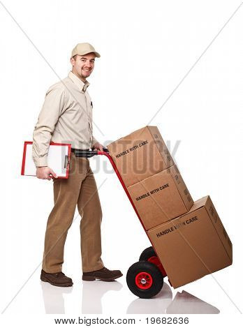 smiling delivery man with red hand truck on white background