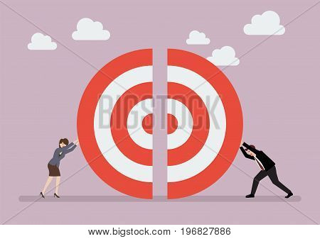 Businessman and woman pushing a pieces of big target together. Teamwork concept