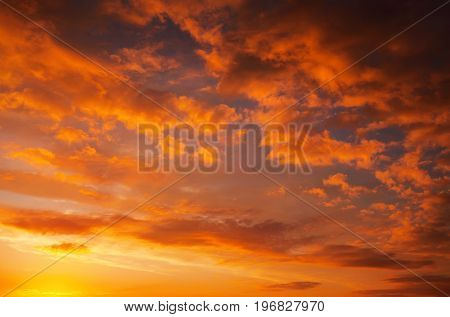 Fiery orange and red colors sunset sky. Beautiful background