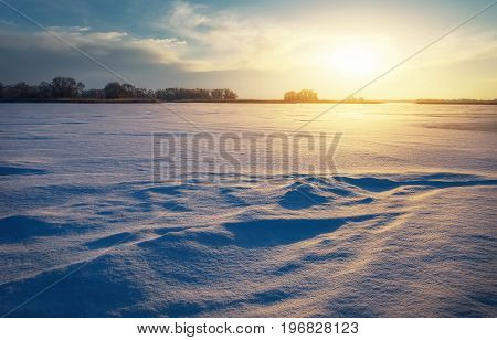 Beautiful winter landscape with lake and sunset sky. Composition of nature.