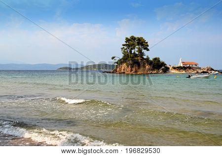Small island with church Agios Nikolaos near Ellinika beach, Euboea- Greece