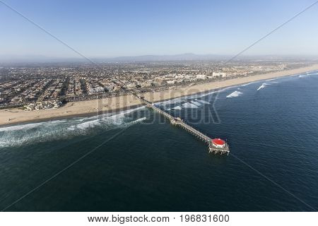Aerial of Huntington Beach Pier on the Orange County Coast in Southern California.