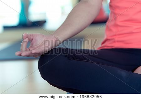 Close up hand asia people practicing and exercising vital meditate yoga in class. Healthy Concept