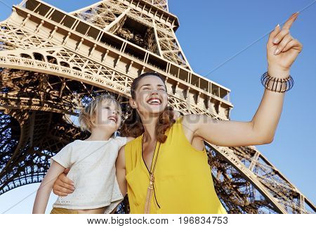 Mother And Daughter Pointing On Something Near Eiffel Tower