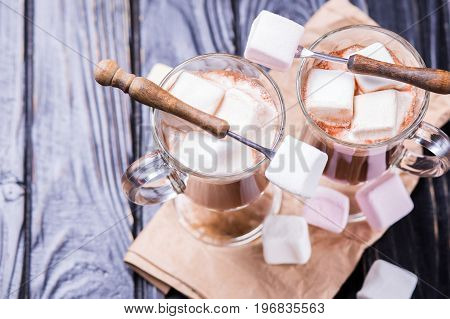 fresh hot cocoa drink with marshmallows in studio