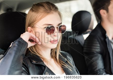 Portrait Of Beautiful And Stylish Woman In Sunglasses Sitting In Car