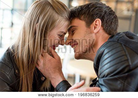 Side View Of Young Man Kissing Beautiful Girlfriend
