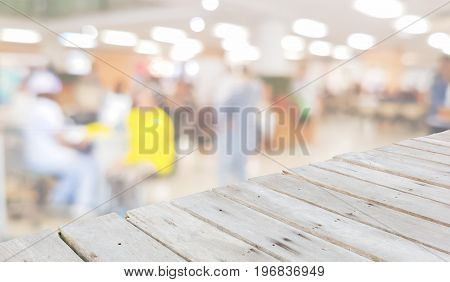 diagonal wooden floor for displaying products on the background of blur hospital interior