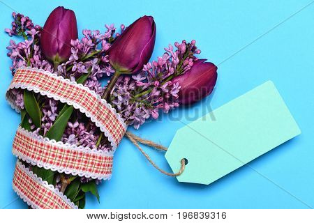 Bunch Of Spring Flowers With Empty Light Blue Price Label