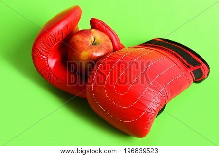 Pair Of Leather Boxing Sportswear With Red Apple. Boxing Gloves