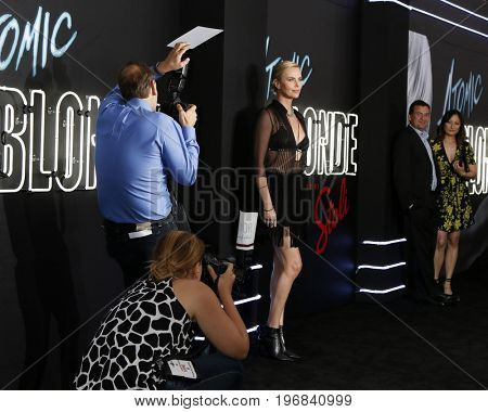 LOS ANGELES - JUL 24:  Carpet photographers, Charlize Theron at the