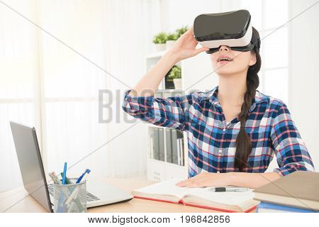 Businesswoman Sitting In Office And Holding Vr