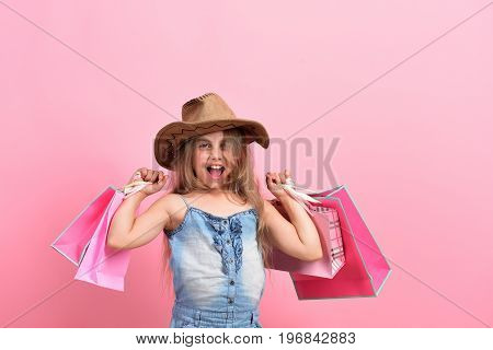 Girl With Pink Shopping Bags. Fashion And Shopaholism Concept