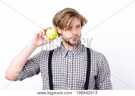 Man With Beard And Stylish Hairdo Holds Green Apple