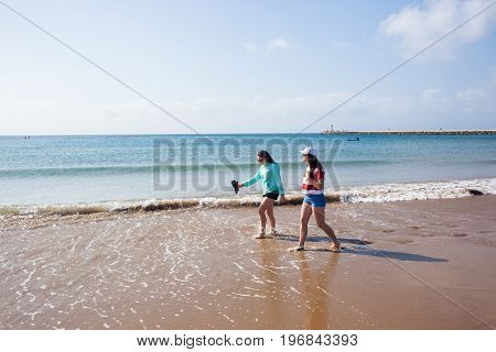 Girls Walking Beach Shoreline Ocean