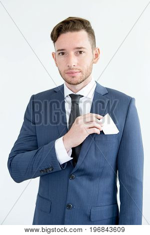 Serious handsome male executive holding blank card and putting it into pocket. Confident consultant presenting himself. New contacts concept