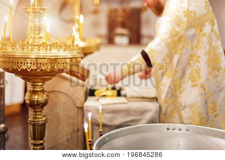 Priest wearing gold robe on ceremony in christian cathedral church, holy sacramental event