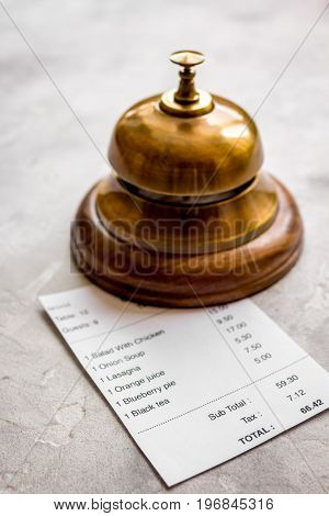 waiter ring and receipt bill for payment by credit card on stone table background
