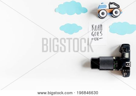 tourist equipment with toys and photo camera for traveling with kids on white background top view mock up