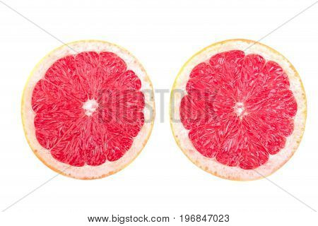 Halves of grapefruits, isolated on a white background. Citrus fruits for healthy snack. Slice of ripe and bright red grapefruit. Two fresh, organic, exotic and juicy grapefruits full of vitamins.