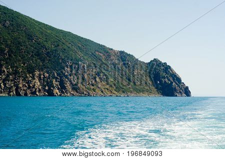 Mighty mountain near a blue transparent sea nature sky