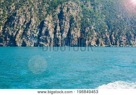 Mighty mountain near a blue transparent sea nature