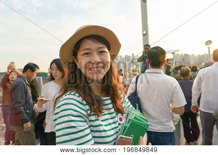 SEOUL, SOUTH KOREA -  MAY 20, 2017: roving tourist information guide at Seoul 7017 Skypark. The Seoullo 7017 Skypark, is an elevated linear park in central Seoul  which opened on May 20, 2017.