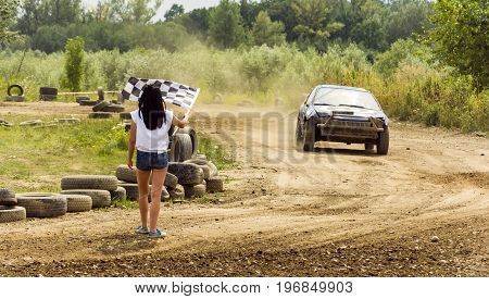 The Girl Announces A Checkered Flag At The End Of The Ride.