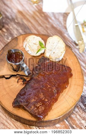 Grilled Barbecued Pork Baby Back Ribs served with bread