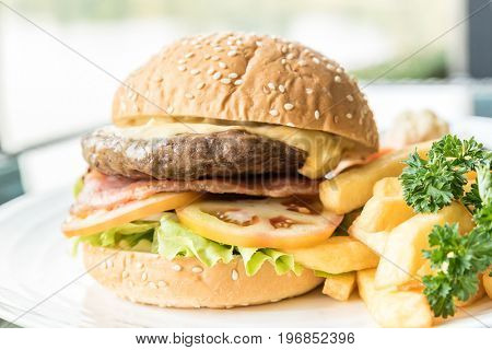 Beef hamburger with fires and fresh vegetable