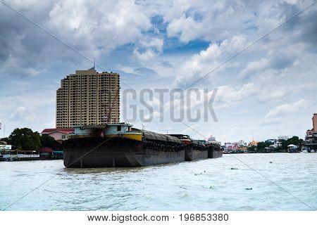 Sand boat is sailing on the Chao Phraya River, Bangkok.