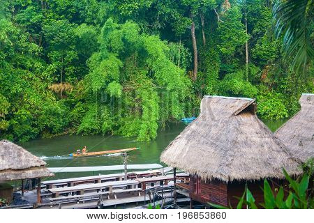The River Kwai. Thailand. May 18 2013: A man is swimming on the river on a motor boat.