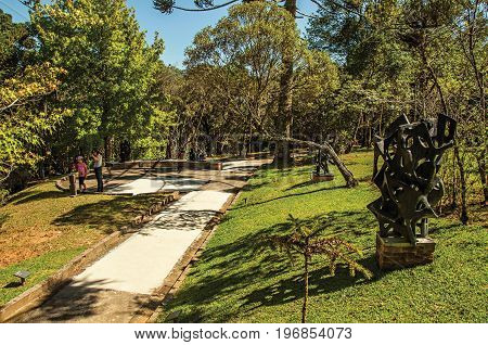 Campos do Jordão, Brazil - January 17, 2015. View of sculptures and people on the open-air Museum Felicia Leirner, near Campos do Jordão, famous for its mountain and hiking tourism. São Paulo State