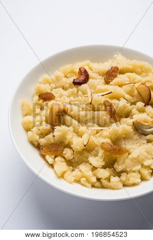 Plain or kesar flavoured Semolina Halwa / Sooji ka Halwa or sweet Rava Sheera or shira - Indian festival sweet made of semolina milk saffron nuts and Ghee