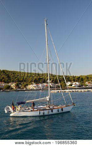 Pefki,Euboea - Greece, July 19 2017: Sailboat leaving Pefki marine